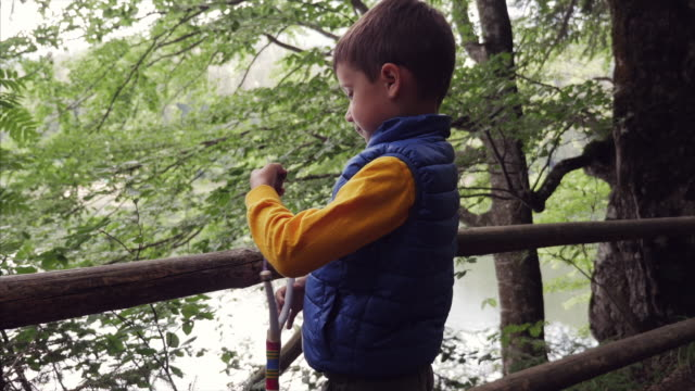 little boy playing with sling toy - catapult stock videos & royalty-free footage
