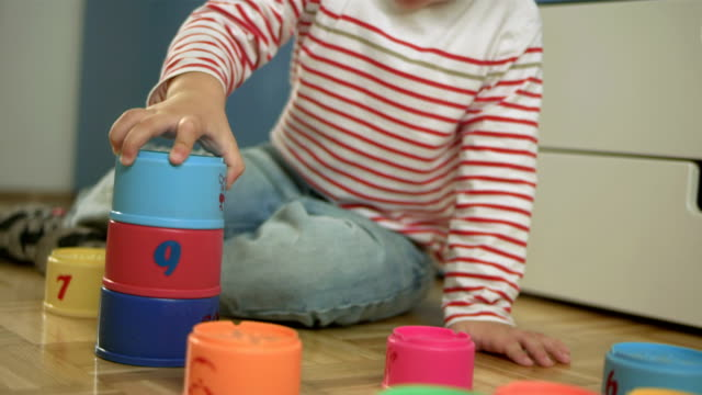 little boy playing with stack cups - toddler stock videos & royalty-free footage