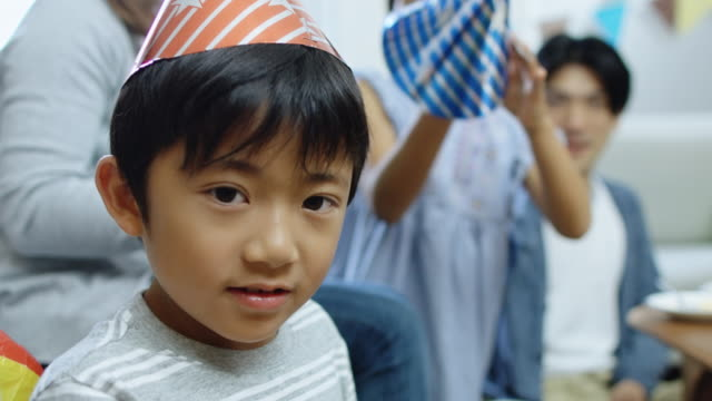 little boy posing with party hat - party hat stock videos and b-roll footage