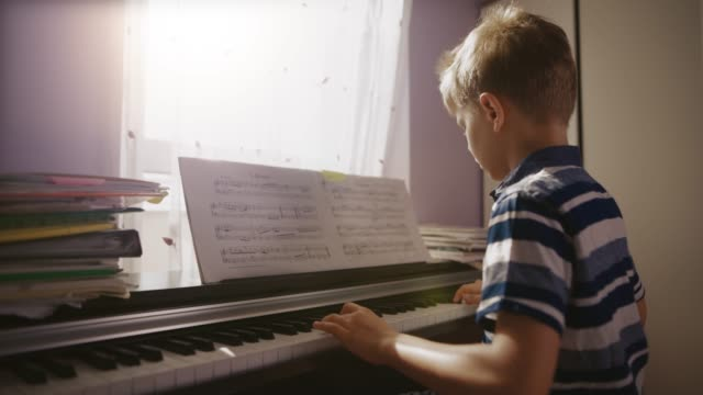 little boy practicing digital piano in 4k - piano stock videos & royalty-free footage