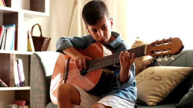 little boy practicing guitar. - guitar stock videos & royalty-free footage