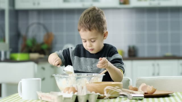 Little boy prepare food