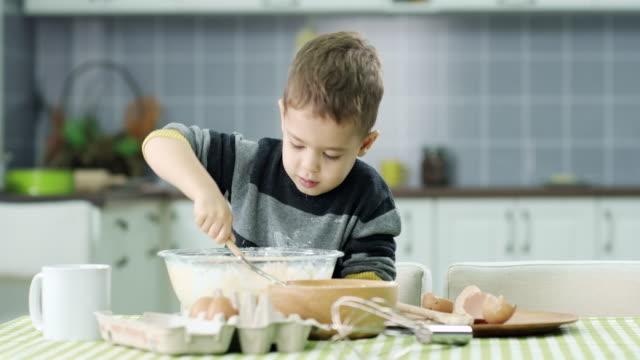 Little boy prepare food