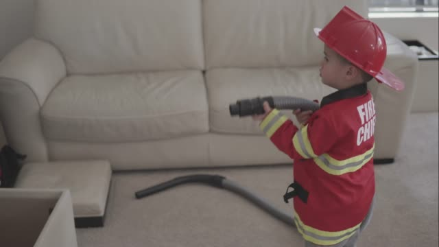 little boy pretending to be a fireman - firefighter stock videos & royalty-free footage