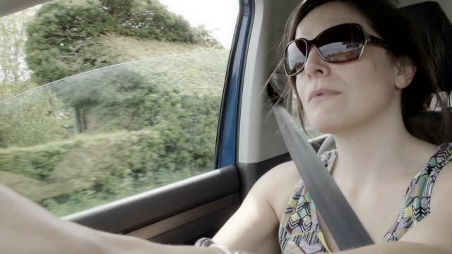 little boy pretending to drive a car like his mother - förare yrke bildbanksvideor och videomaterial från bakom kulisserna