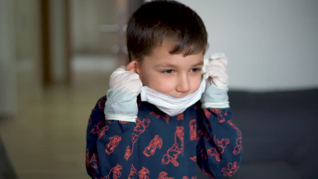 little boy removing surgical mask and protective gloves at home - 2019 stock videos & royalty-free footage