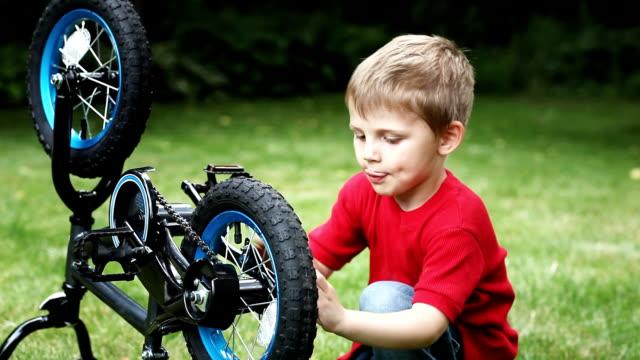 Little Boy Repairing Bike