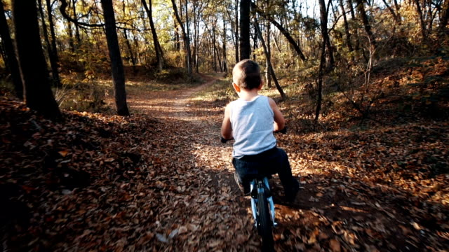 little boy riding a bike - exploration stock videos & royalty-free footage