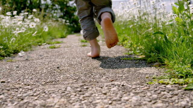 slo mo little boy running at backyard - low angle view stock videos & royalty-free footage