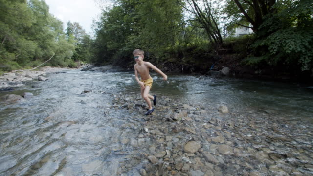little boy running in the cold mountain river - recreational pursuit stock videos & royalty-free footage
