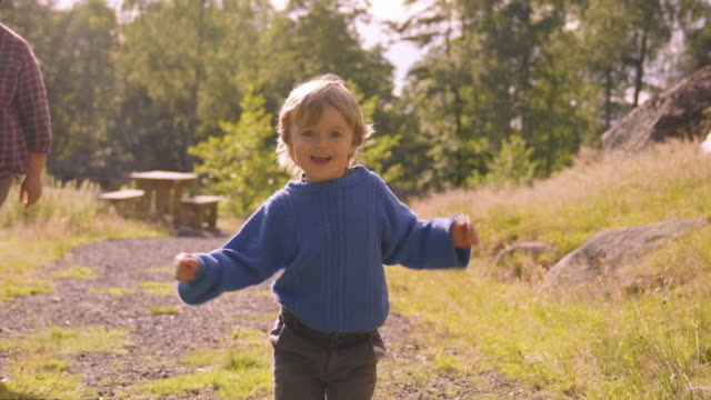 little boy runs toward camera on path - misfortune stock videos & royalty-free footage