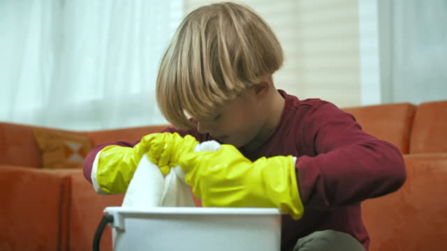 hd: little boy scrubbing the floor - chores stock videos & royalty-free footage