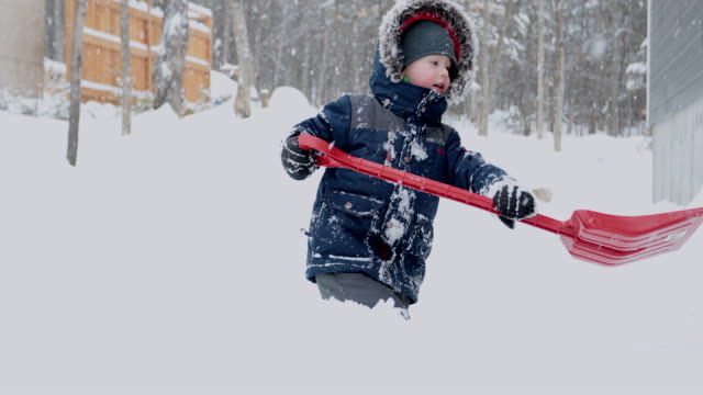 little boy shoveling snow after winter storm. - digging stock videos & royalty-free footage