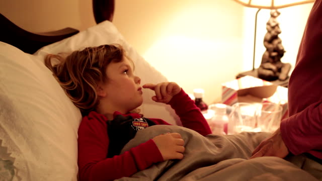 little boy sick in bed - illness stock videos & royalty-free footage