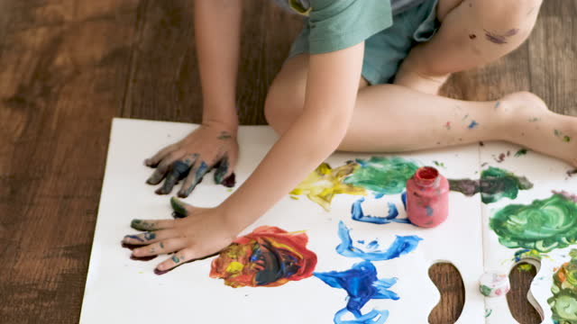 little boy sitting on the floor finger-painting - craft stock videos & royalty-free footage