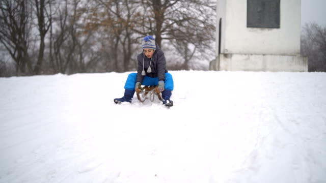 little boy sledding - sliding stock videos & royalty-free footage