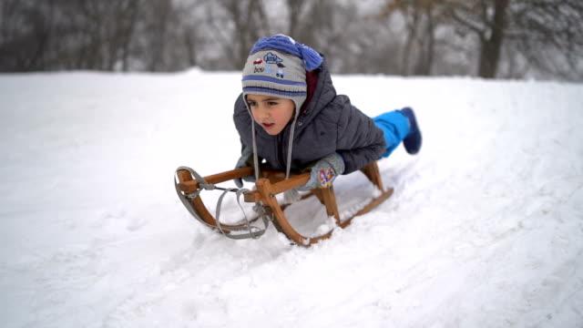 little boy sledding - sledge stock videos & royalty-free footage