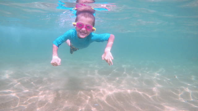 little boy snorkeling in mexico beach - swimming goggles stock videos & royalty-free footage