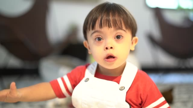 little boy special needs at home - sindrome di down video stock e b–roll