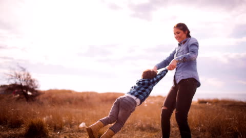 little boy spinning in his mother's arms - mother's day stock videos & royalty-free footage