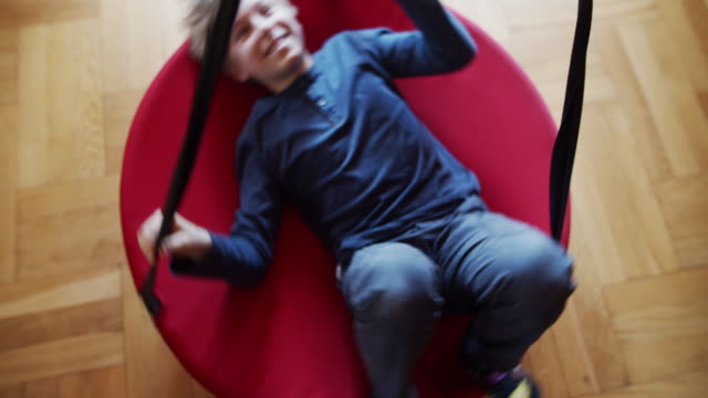 little boy spinning on swing at home - turning stock videos & royalty-free footage