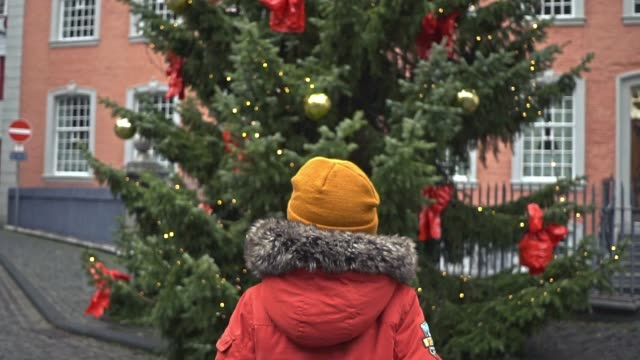little boy  standing near christmas tree in monschau - advent stock videos & royalty-free footage