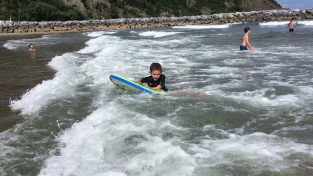 Little boy surfing