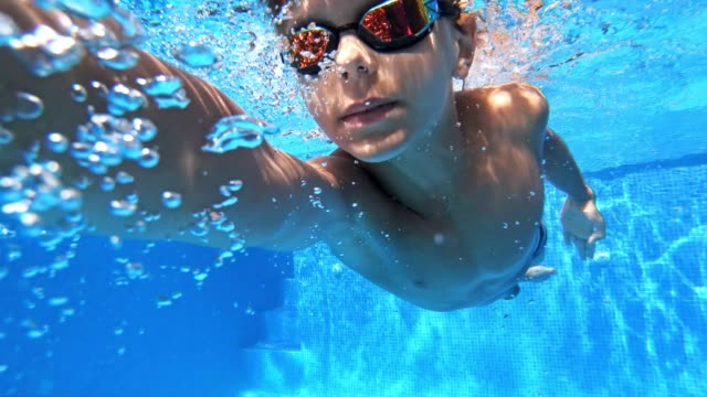 little boy swimming crawl in pool - swimming stock videos & royalty-free footage