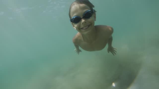 little boy swimming underwater in sea - undersea stock videos & royalty-free footage