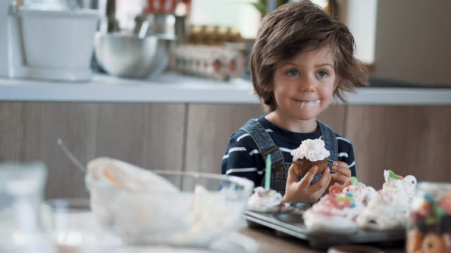 little boy tasting birthday muffins - cupcake stock videos & royalty-free footage
