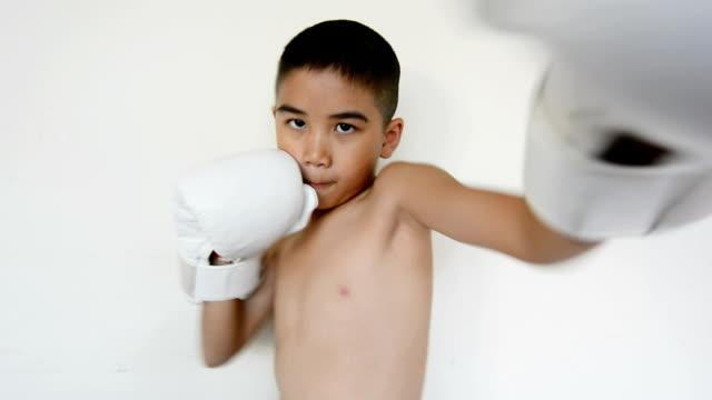 Little boy training boxing