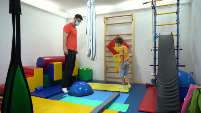 little boy training his balance at rehabilitation center - invisible disability stock videos & royalty-free footage