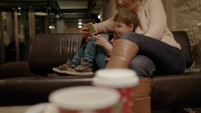 Little boy using a mobile phone  4K