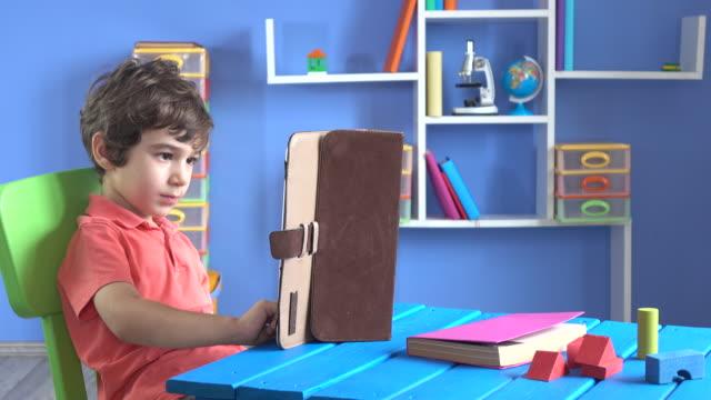 Little Boy Using Digital Tablet In His Room