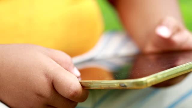 Little boy using tablet, Slow motion