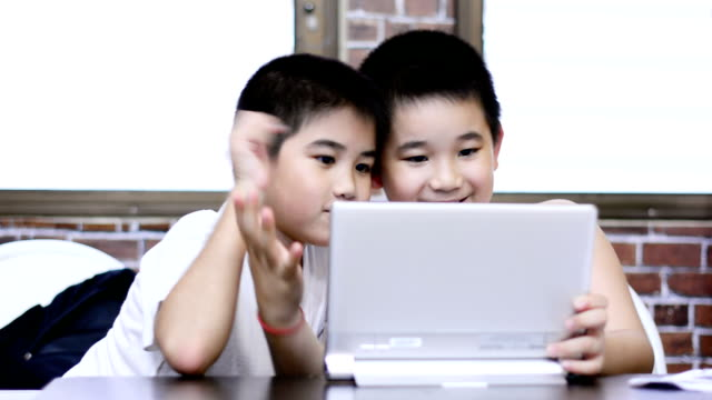 little boy using tablet - adult imitation stock videos & royalty-free footage