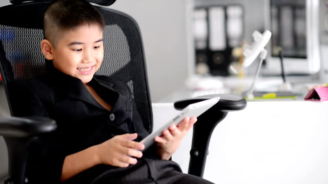 little boy using tablet - adult imitation stock videos and b-roll footage