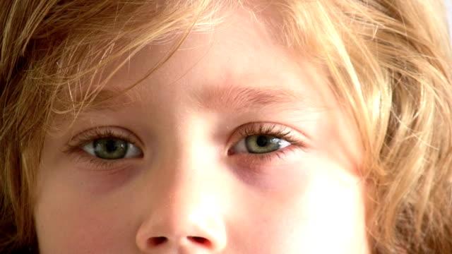 little boy - sideways glance stock videos & royalty-free footage