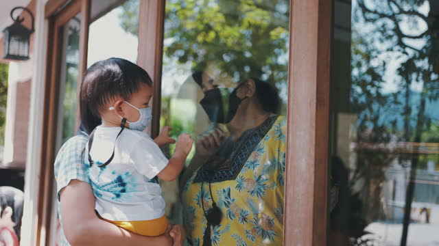 little boy visits grandmother during pandemic covid-19 - emotional support stock videos & royalty-free footage