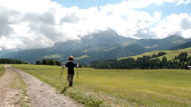 Little boy walking on Seiser Alm - Alto Adige