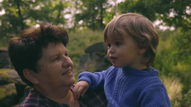 little boy walks with grandmother in nature - farmer stock videos & royalty-free footage