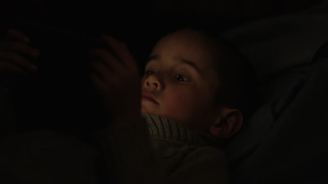 little boy watching a video - fatcamera stock videos and b-roll footage