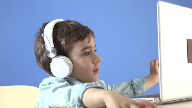 little boy watching film on notebook computer - selimaksan stock videos & royalty-free footage