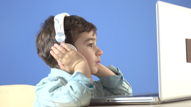 Little Boy Watching Film On Notebook Computer