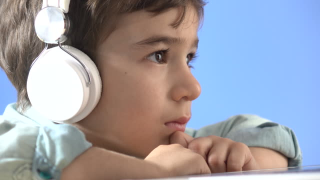 little boy watching film with headphones - selimaksan stock videos & royalty-free footage