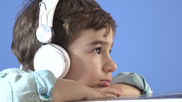 little boy watching film with headphones - headphones stock videos & royalty-free footage