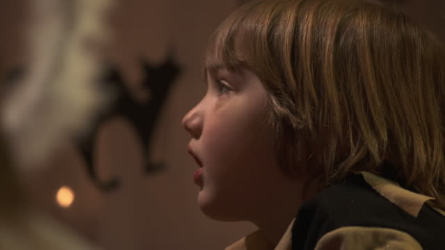 hd dolly: little boy watching theatrical performance - storytelling stock videos and b-roll footage