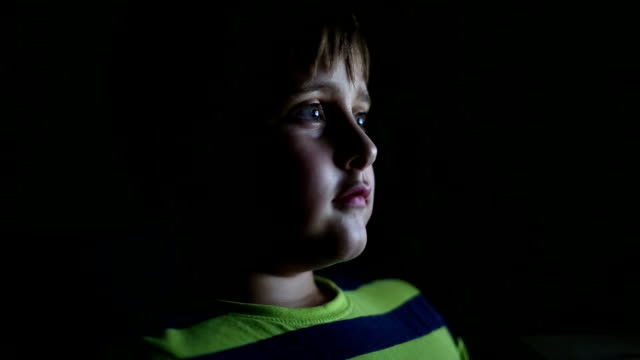 little boy watching tv at night - spooky stock videos & royalty-free footage