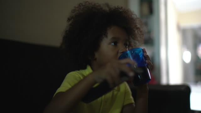 little boy watching tv in the living room - television stock videos & royalty-free footage