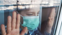 Little boy wearing anti virus mask staying at home